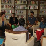 Linda Donovan, Spiritan Campus Minister, moderates an informal discussion about religious tolerance and cultural differences among attendees.