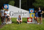 (L-R) Aaron Thomas, Anjali Singh, Mary Ames, Jessica Livingston and Elizabeth Faber pose in front of the Guadalupe day care.