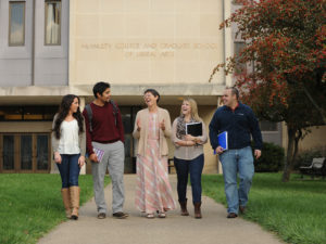 Students and faculty outside the liberal arts building