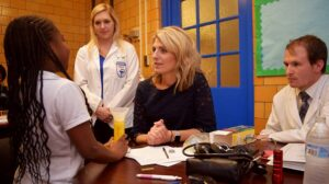 Dr. Jennifer Elliott (center) speaks with a student during a screening last year.
