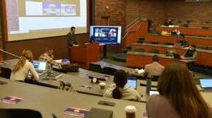Photo of a lecture hall with professor and students