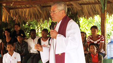 The Rev. Donald J. McEachin, C.S.Sp., talking in front of a group